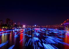 The 100.000 Blue Orbs Floating Down a River In Tokyo  On the Sumida River in central Tokyo were captured these amazing photos where you can see 100,000 blue orbs floating. These is the kick off for the inaugural two day Tokyo Hotaru Festival. These LED's dubbed prayer stars are big enough so the fish can't swallow them.
