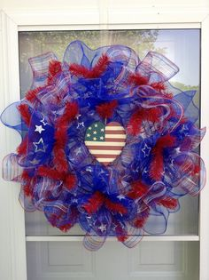 Patriotic wreath I made for my side door...good thing about these is that I can leave it up through Labor Day.