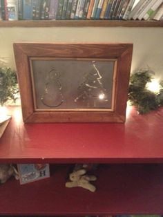 My husband made this metal snowman and christmas tree picture. He then made the frame and stained it, too.