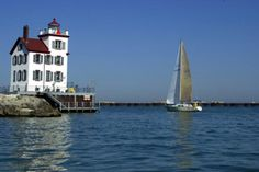 """Lorain lighthouse sits at the end of the west breakwater in Lorain harbor. The structure, built in 1916, guided Lake Erie ships for 50 years before being allowed to fall into disrepair. The lighthouse was scheduled for demolition in the 1980s before a grass-roots effort saved the building. The three-story keeper's house is made of poured concrete with walls 10"""" thick to keep out the sometimes fierce Lake Erie storms."""