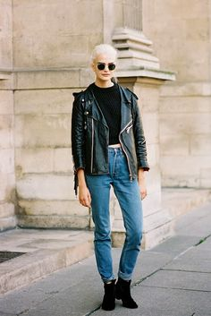 25 Ways to Make Mom Jeans Look Modern - sleek platinum locks paired with a black crop top, cuffed mom jeans + a leather moto jacket and ankle boots — too cool. | StyleCaster