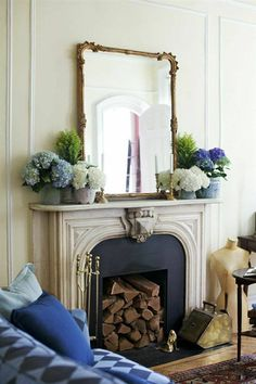 A rectangular wall mirror with a gilded frame over a mantel in a living room