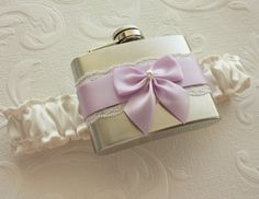 In the alternate universe where I will end up married...I would totally get one of these garter flasks. Fucking awesome.  I would totally get it in a deep green or purple. <3