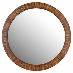 """Circular wall mirror.  Product: Wall mirrorConstruction Material: Wood and mirrored glassColor: BrownFeatures:  Traditional styleElegant and practical  Dimensions: 35"""" Diameter"""