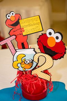 Sesame Street and Elmo birthday party centerpieces! See more party ideas at…
