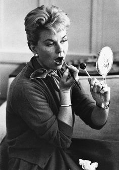 Doris Day putting on lipstick. Photographed by Don Ornitz.