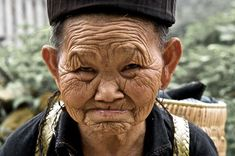 Vietnamese Woman-  A close portrait of a H'mong woman in Sapa, Lao Cai Province, Vietnam