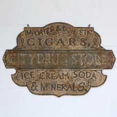 Our Drug Store sign is such an iconic piece. Use these rusted metal Signs as hanging Retro Signs to create a historic look while adding dimension to any space! For more visit, Decor Steals