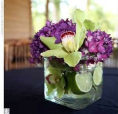 green and purple wedding centerpieces- yellow or pink would be so pretty too