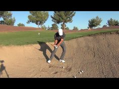 Ball off left foot, weight on left foot, cock wrists, club face open, hit 2in. behind ball, left shoulder doesn't lift up...moves around, take thin slice of sand and follow through.