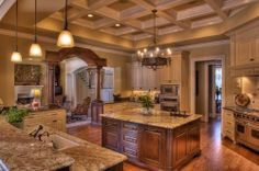 Great kitchen. Kitchen island. Storage. Countertops. Cabinets. Pendant lights. Granite counters. Wood floors. Built-ins. Drawers. Open kitchen.