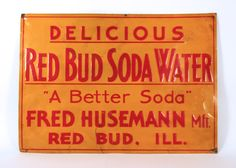 Circa 1920s Metal or Tin Soda Sign from the Fred Husemann Soda Bottling Company in Red Bud, Illinois.   Mr. Husemann was in business from approximately 1920 to 1960 in this town in Randolph County, IL.