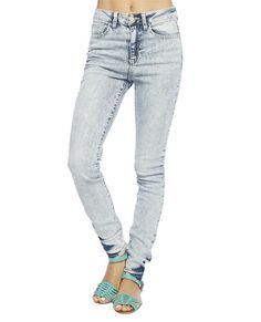 """Get that retro chic look in this must have skinny by Cello Jeans, featuring an acid washed stretchy body with five pocket design, button and zip closure, and and a high waisted construction.    Model is 5'9"""" and wears a size 5      30"""" Inseam  10"""" Leg Opening  99% Cotton / 1% Spandex  Machine Wash  Imported"""