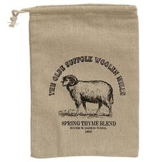 """Olde Suffolk Woolen Mills Sheep Drawstring Bag is a drawstring fabric bag that features a sheep design and displays the words, """"The Olde Suffolk Woolen Mills."""" Bag measures high by wide and deep."""
