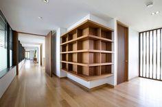 Built-in bookshelf. I like the contrast of the wood against the white. Albatross Mansion in Australia