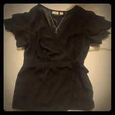 Blouse Black blouse size small from Cato. NWOT. Perfect for date night or to the office with your colored dress pants. Feminine ruffled sleeves, button and tie closure. So many possibilities with this top! Unfortunately I'm a medium or I'd keep it. Cato Tops Blouses