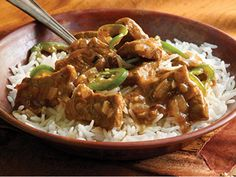 Beef and Onion Stew (Beef Bhoona) - Bhoona is a method of slow cooking spices and meat until tender. It is very well suited to beef. Use stewing beef and look for meat with some marbling, for that will give the best flavor and the most tender texture. Accompany with Khichri, a kind of easy pilaf of rice and dal. In a traditional Bangla-style meal, if you served plain rice with the beef bhoona, you would also serve a simple dal, as well as a green vegetable....| Dining for Women
