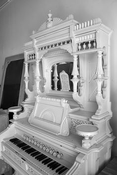 Ornate old organ painted white makes an unusual focal point. Looks too cool as a display area if it doesn't (or you don't) play.