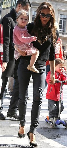 Yummy mummy: Victoria looked as stylish as ever as she made the extra effort for her public outing