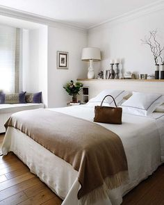 room-width shelf over the bed