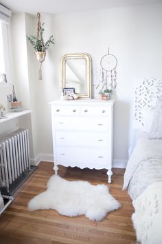 bedroom before and after, bedroom makeover, boho bedroom, bohemian bedroom, light and bright home decor, apartment decor, urban outfitters headboard, anthropologie bedding, white dresser, white bedroom, gold mirror, dream catchers, sheepskin rug