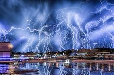 Lightning bolts illuminate the sky in a near-Biblical  composite image made up of dozens of photographs in Johannesburg, South Africa