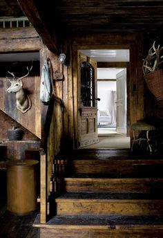 This looks like its the entry into the farmhouse from a garage - love that the rustic beauty is continued through the space, always a little weird to have a modern garage plopped onto a rustic cabin.