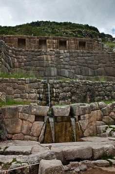 """Tambomachay~~~~Tambomachay is known as """"the bath of the Incas"""". It consists of a series of aqueducts, canals and waterfalls that run through the terraced rocks."""