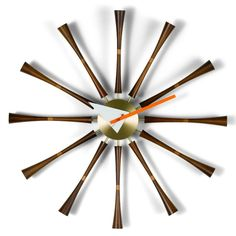 "George Nelson Spindle Clock Belief in progress and growing economic prosperity were central aspects to the American way of life in the 1950's. Everything seemed possible and people strove to be ""moder"