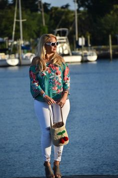 Street2BeachStyle – Floral Off the Shoulder Blouse with White Distressed Jeans in Tarpon Springs, Florida. Floral Print | Floral Blouse | Summer Outfits | Spring Style | Summer Style | Distressed Jeans | Off the Shoulder Top | Cherry Print | Bucket Bag | Stylish Outfits | Wedges #street2beachstyle #floralprint #floral #tasselearrings #distressedjeans #springstyle #summerstyle #offtheshoulder #cherryprint #bucketbag #strawhandbag #wedges Instagram: Jenn Truman @jtstjtst11