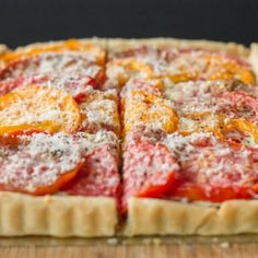 Goat cheese, sweet caramelized onions and end-of-season heirloom tomatoes get together in a buttery savory pie shell.  Delicious!