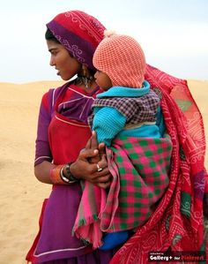Mama and baby in colourful clothes.