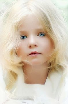 Precious Blonde-Haired Little Girl in White