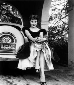 Debra Paget, and my two favorite things, vintage cars and a peek of petticoats.