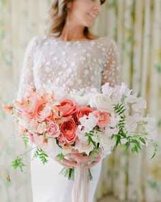 Wilder Floral Co. created this wide, lush bouquet of pink and white blooms (including sweet peas, garden roses, stock, and ranunculus), which was tied with trailing ribbons in blush and ivory.