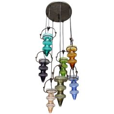 View this item and discover similar for sale at - Chandelier stalactites with seven colorful glass pendants by Nanny Still-McKinney for RAAK Amsterdam. Nanny Still McKinney Chandelier Pendant Lights, Modern Chandelier, Chandeliers, Glass Pendants, Colored Glass, Wind Chimes, Amsterdam, Modern Furniture, Design Art