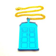 Tardis shaped pendant, fashioned from 3mm laser-cut mirror-blue acrylic, with engraved details. Measures approximately 30mm by 65mm. On a 46cm gold plated curb chain. Nickel and lead free. For Doctor Who loving time travellers everywhere!