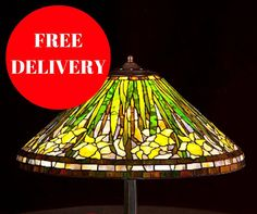 Size: • Height 55 cm (21,6) • Diameter of shade 50 cm (19,7) • Amount of glass pieces: 684 Main style of the lamp: unique Tiffany pattern with daffodils  Stained glass lamp, made using L.C. Tiffany metod of copper foil and glass from Uroboros and Youghiogheny. These are American most famous glassworks. Every glass pane is manmade. Solders are very solid and smooth, what guarantee durability for dozens of years. It's handmade product made in Gdansk, Poland. Lamp is very nice in touch and…