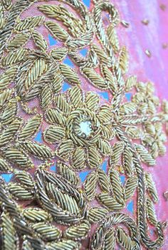 Pink and gold Indian Zardozi embroidered wedding head scarf or shawl dating to the mid 20th century.