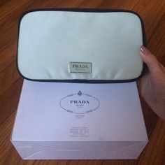 Prada infusion D'IRIS textile makeup pouch Brand new in box prada makeup pouch! Great pouch and fits many makeup essentials! Nice size as well! Has two pockets inside as shown in fourth photo. Light green color and black sides Prada Bags Cosmetic Bags & Cases