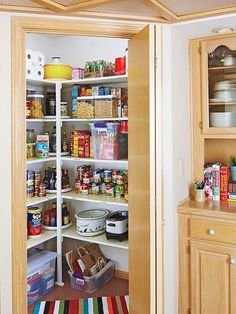 Peaceful Pantry | I like the tupperware with paper goods on the floor.  Keeps the food off of the floor but uses that space.