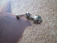 belly button jewelry sea turtle with a light aqua stone belly rings
