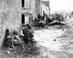 Men of US Army 2nd Infantry Division advancing into Brest France under German machine gun fire 9 September 1944.