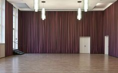 The much-celebrated international artist Thomas Demand used Kvadrat Soft Cells acoustic panels to create a site-specific work in the Städel Museum's Metzler Hall in Frankfurt. The installation, entitled 'Saal' (Hall 2011), is an illusion-making crimson curtain, covering all four walls of the giant hall.  Initially, the curtain gives the impression of draping to the ground in wave-like folds. But, as the viewer approaches, it is revealed to be a completely flat piece with deliberately ...