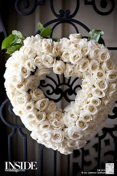 roses heart wreathe...maybe on the ends of the pews/chairs.