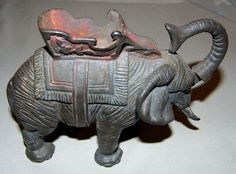 Vintage Cast Iron Elephant Bank - The Trunk Tosses a Coin Into the Bank | Flickr - Photo Sharing!