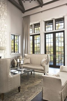 Suzie: Linda McDougald Design - Chic living room with wall of French doors & transom windows, ...
