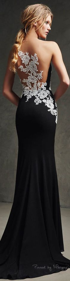 Pronovias 2016 - white lace snakes down the back of this slinky black stunner. #promwhitedress