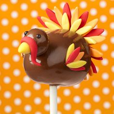 Lots of chocolate to be thankful about on this chubby turkey pop. It's a brownie pop covered with light cocoa Candy Melts candy, and a malted milk ball for its head!