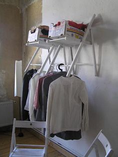 This is so clever and unique way to store and hang the clothes by using folding chairs.